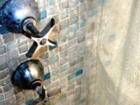 natural stone tiles in the shower with damage